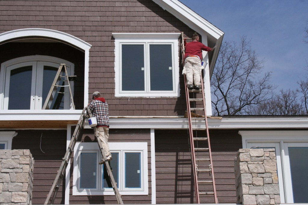 Exterior painting - Painting the exterior of your house concept ...
